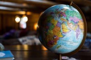 Photo of a Globe by Kyle Glenn on Unsplash